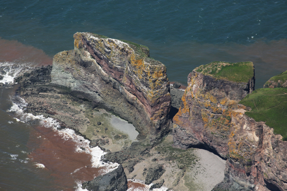 Cape Split on the Bay of Fundy, Nova Scotia, Canada. The cape is photographed with the tide about four hours from full flood. Photo by Eric with help from Andrew Robertson, piloting his Cessna 172.